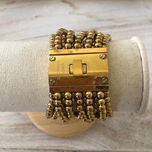 Michael Kors gold bracelet.